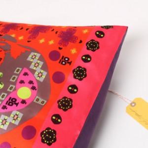 cushion-label-red-buddha